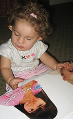 A child touching a booklet