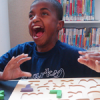 A young boy learning literacy skills by playing with letter blocks